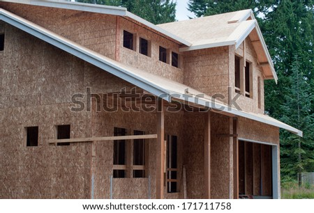 View of a new home still under construction - stock photo