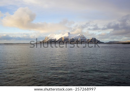 View of a Norwegian fjord with snowy mountain, Nordland, Norway