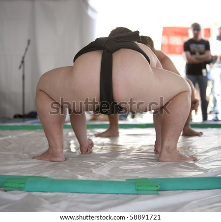 View of a pair of sumo wrestlers about to grapple. - stock photo