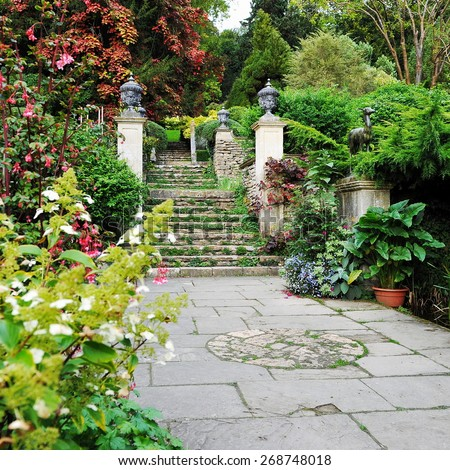 View of a Patio Courtyard in a Beautiful Secluded English Garden - stock photo