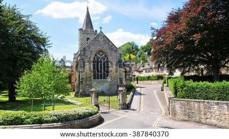 View of a Picturesque Old Street and Church in an English Town - Namely the Landmark Bradford on Avon in Wiltshire England - stock photo