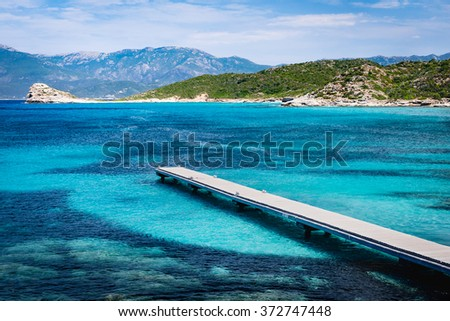 View of a pier in beautiful turquoise lagoon on Corsica island (France)