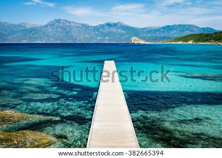 View of a pier in beautiful turquoise lagoon on Corsica island (France) - stock photo