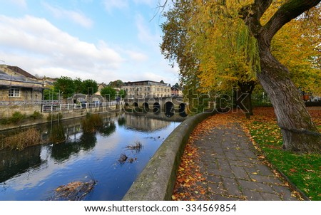 View of a Riverside Path through a Beautiful Park in Autumn - stock photo