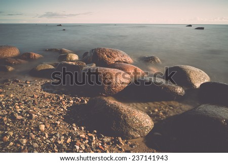 View of a rocky coast in the morning. Long exposure shot. - retro, vintage style look