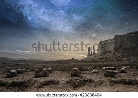 view of a rocky desert landscape at dusk - stock photo