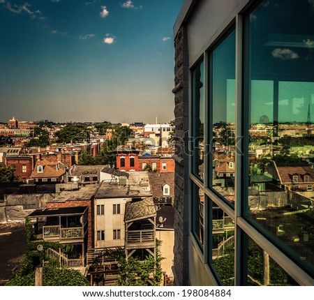 View of a run-down residential area from a parking garage in Baltimore, Maryland. - stock photo