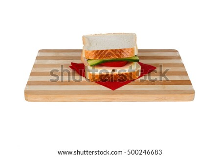 View of a sandwich with cheese, tomato and cucumber, isolated on white background.