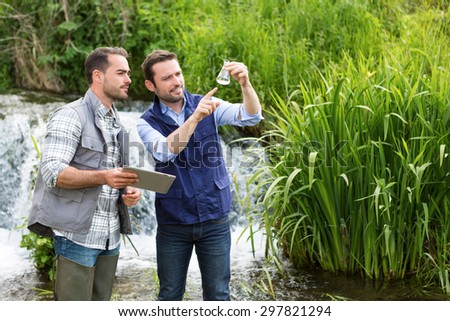 View of a Scientist and biologist working together on water analysis - stock photo