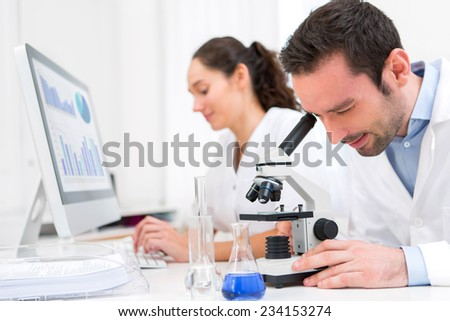 View of a Scientist and her assistant in a laboratory