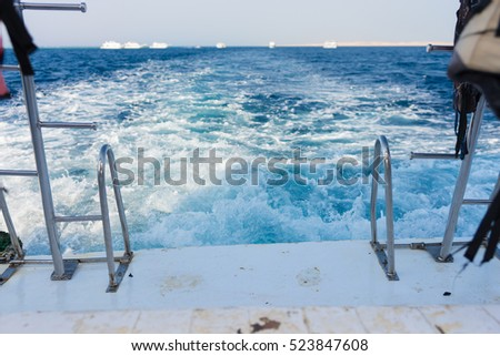 View of a ship's wave wake in a turquoise sea