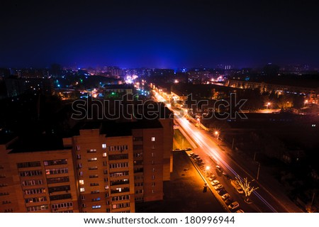 view of a small town at night - stock photo