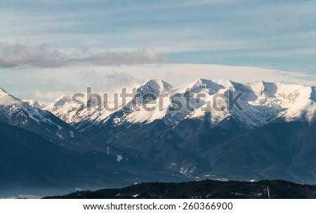 View of a Snow Capped Mountain Range   - stock photo