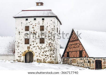 View of a snow covered Hovdala Castle in Hassleholm region. Hovdala Castle is a castle in Hassleholm Municipality, Scania, in southern Sweden. - stock photo