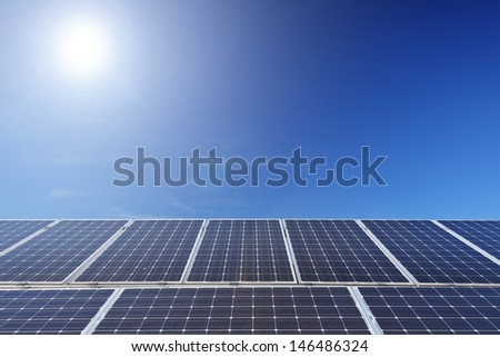 View of a solar photovoltaic cell panels under sun - stock photo