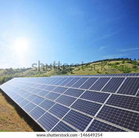 View of a solar photovoltaic cell panels under sunny sky, shot with a tilt and shift lens - stock photo