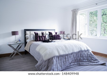 View of a spacious and tidy bedroom - stock photo