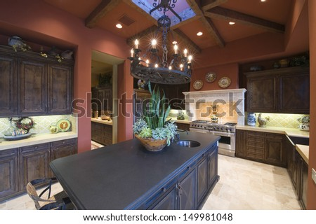 View of a spacious kitchen with island in house - stock photo