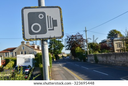 View of a Speed Camera Warning Sign on a City Street - stock photo