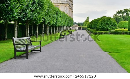 View of a Stone Pathway through a Beautiful Green Park in Summer - stock photo