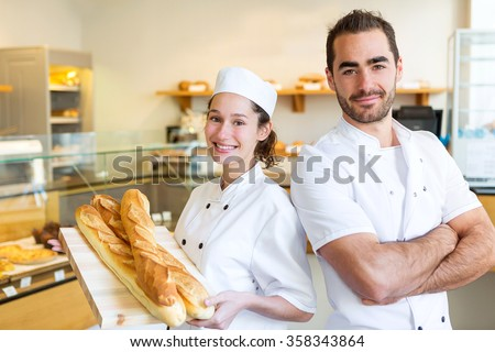 View of a Team of bakers working at the bakery - stock photo