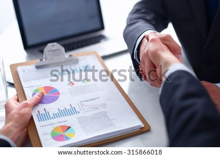 View of a team of businesspeople  shaking hands - stock photo