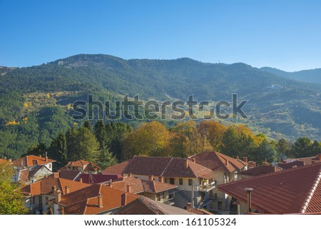 View of a traditional village house in the fall with all the colorful foliage - stock photo
