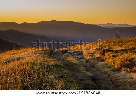 View of a trail that passes through this stunning scene over the Blue Ridge Mountains in North Carolina. Taken along the Art Loebe Trail where hikers and backpackers enjoy the scenery. - stock photo