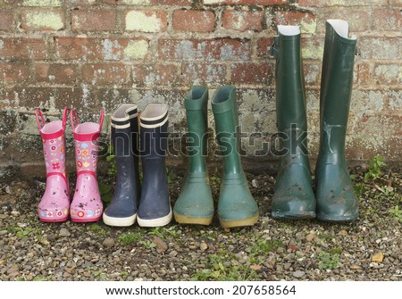 View of a variety of rubber boots in a row - stock photo