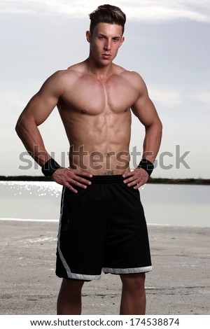 View of a very fit male model with muscles.Fashion colors.
