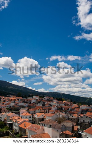 View of a village and surrounding countryside, Folgosinho, Portugal, Western Europe. - stock photo
