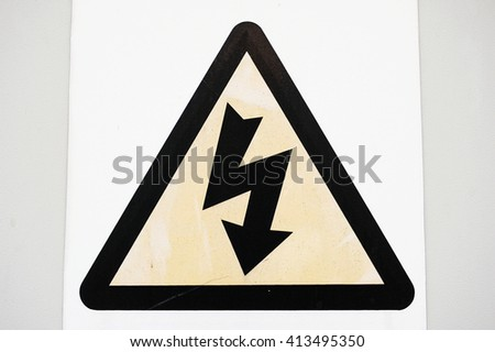 View of a Weathered Electric Shock Sign - stock photo