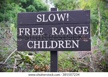 View of a Weathered Free Range Children Sign - stock photo