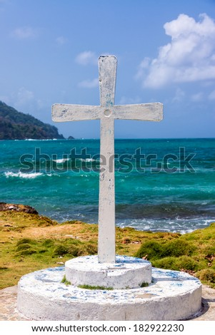 View of a white cross with the Caribbean Sea in the background at La Miel, Panama