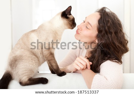 View of a woman  having good times at home with cat