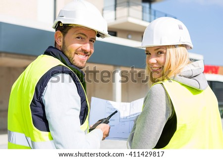 View of a Worker and enginner checking last details before delivery