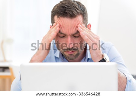 View of a Young attractive business got headache because of burn out - stock photo