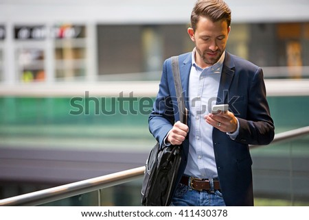 View of a Young attractive business man using smartphone - stock photo