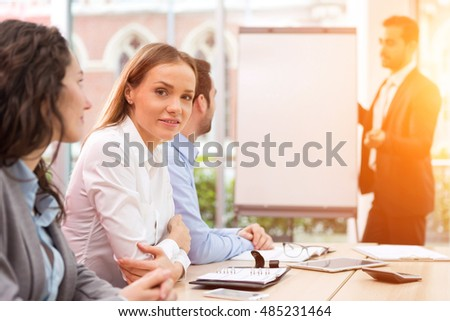 View of a Young attractive businesswoman working at the office with associates