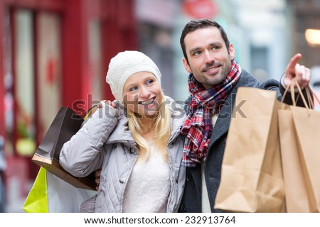 View of a Young attractive couple with shopping bags - stock photo