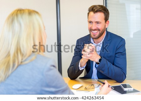 View of a Young attractive employer doing a job interview to a woman - stock photo