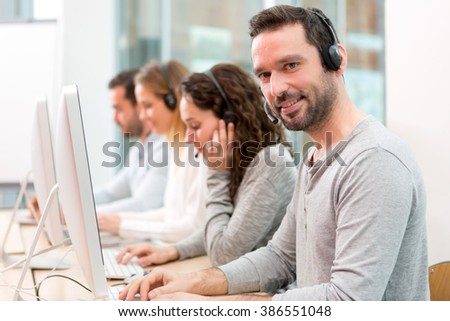 View of a Young attractive man working in a call center