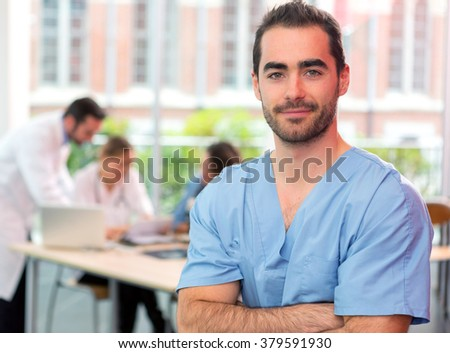 View of a young attractive nurse at the hospital - stock photo