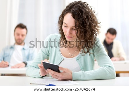 View of a Young attractive student during mathematics classes - stock photo
