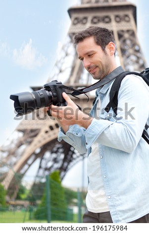 View of a Young attractive tourist taking pictures in Paris, France - stock photo