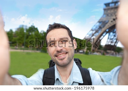 View of a Young attractive tourist taking selfie in Paris - stock photo