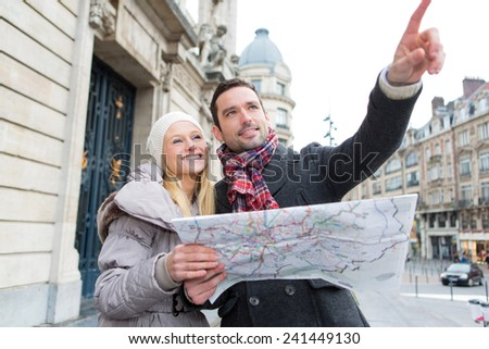 View of a young attractive tourist watching map  - stock photo