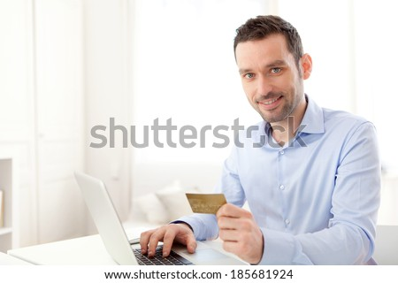 View of a Young business man paying online with credit card  - stock photo
