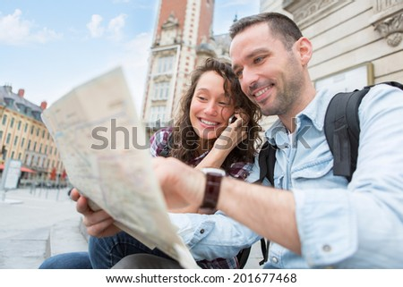 View of a Young couple of tourists booking hostel