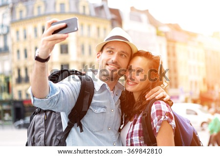 View of a Young couple on holidays taking selfie - stock photo